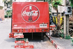 Things Go Better With Coke (35mm) (jcbkk1956) Tags: street trees red film truck 35mm canon thailand bottles drink bangkok coke lorry rubbish cocacola bins crates softdrinks 50mmf18 deliveries thonglo analong