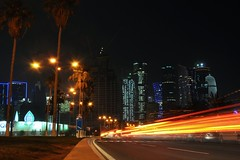 Corniche (Thorsten Reiprich) Tags: street city urban travelling cars skyline night speed palms lights spring asia downtown gulf skyscrapers traffic capital heat peninsula qatar