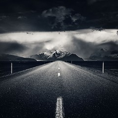 Enter A Mountain Storm -- Iceland (Mabry Campbell) Tags: road blackandwhite storm black mountains clouds dark square landscape photo iceland highway moody image fav50 fineart perspective nopeople fav20 photograph squareformat april walden fav30 fineartphotography roadscape fav10 fav100 fav200 fav300 2013 fav40 fav60 fav90 fav80 fav70 instagramapp uploaded:by=instagram mabrycampbell