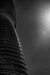 Absolute Tower (Dan Fleury) Tags: light sky urban blackandwhite white toronto black building tower architecture dark pattern balcony condo mississauga residential bnw absolute sidelight