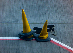 Do Not Step Out of Line (Steve Taylor (Photography)) Tags: chocks cone black grey red yellow white concrete plastic uk gb england greatbritain unitedkingdom london lines diagonal airport heathrow terminal