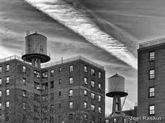 Wald Tanks (Joel Raskin) Tags: watertank roofscape rooftop apartmentbuildings nyc newyorkcity nycha lowereastside eastvillage citylife city urban lillianwaldhouses blackandwhite