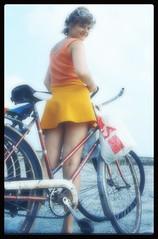 A day at the sea... in the mid seventies. (iEagle2) Tags: analog analogfilm analogue colorslide denmark danishwestcoast ehefrau female femme frau film legs seventies sea sexy minolta summer srt101 woman wife beach bike