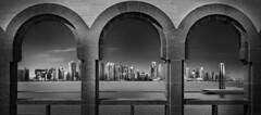 Skyline from Museum arches (Minas Stratigos) Tags: fine art bw envisionography doha qatar mia skyline sony a7rii museum