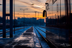 The Train Station (modestmoze) Tags: train station traintracks reflection 2017 february winter snow white grey sky clouds blue orange red pink column lines leadinglines explore travel sunset one moving outside outdoors vilnius lithuania black shadows beautiful view metal glass sidewalk ice