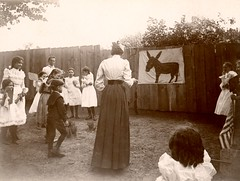 Pin the Tail on the Donkey (Alan Mays) Tags: ephemera photographs photos foundphotos donkeys animals tails pinthetailonthedonkey games playing play women teachers blindfolds blindfolded tall thin slim children boys girls students fans advertisingfans flags clothes clothing dresses sailorsuits fences antique old vintage vptp