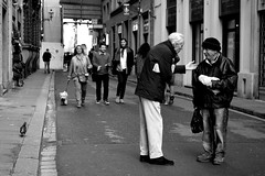 a friendly meeting . (Roi.C) Tags: florence italy street people black blackwhite white walking talking friends nikon 5300