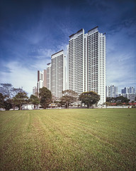 Bukit Batok New Heights (Scintt) Tags: singapore buildings architecture weather clouds sky sun light glow large format fuji rdp slide colour positive film silver 4x5 gaoersi 58mm wide angle super angulon schneider travel hdb housing estate homes apartments tiles lines patterns textures blue green blocks flats iconic surreal empty scintillation scintt jon chiang photography tetenal e6 diy self develop structure colourful vibrant saturated tilt shift clear provia bukit batok jurong east afternoon grass trees field skyscrapers