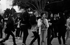 Young People Madness (burnt dirt) Tags: houston texas mainstreet downtown street streetphotography city town bw people person girl woman cold park celbritysighting discoverygreen youngpeople teenagers group crowd man boy laugh smile happy cellphone glasses fujifilm xt1