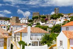 Óbidos V (Cataphract) Tags: castleofóbidos church igrejadesantiago obidos portugal flag óbidos leiria