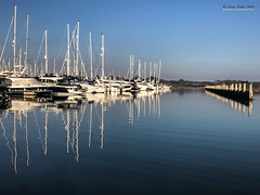 Lymington Marina (jerry_lake) Tags: lymingtonmarina converginglines reflections lymington iphone