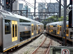 Sydney Trains - Divergent Waratahs from the end of Platform 22 (john cowper) Tags: waratahset centralrailwaystation sydneytrains suburbanrailways sydney newsouthwales
