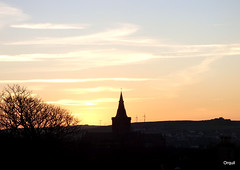 The Saint MagnusCathedral Spire (orquil) Tags: stmagnuscathedral spire steeple silhouette skyline windturbines corse farm leafless bare tree kirkwall town sunset golden colours big blue sky streaky white clouds skyscape january afternoon winter orkney islands scotland uk unitedkingdom orcades nice interesting memorable