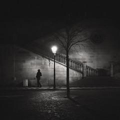 Nightwalker (Vesa Pihanurmi) Tags: malástrana charlesbridge night prague praha lanterns lamppost streetphotography karlůvmost monochrome blackandwhite stairs man figure