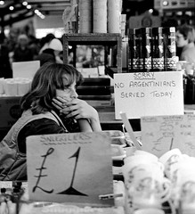Leicester market. (col-h) Tags: people history argentina 35mm waiting notice market leicester bored humour 1980s sullen handwritten reaction trader falklandswar