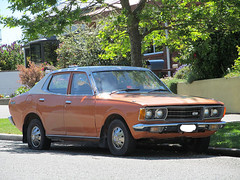 1977 Datsun 180B (mine was tan-brown) (LoxPix2) Tags: loxpix hondan600g austina30 hondas600 hondas800 bmw318is coupe benz c200 sports kompressor amg merecedes ford falcon xl xk futura wolseley 2480 humber supersnipe ml320 landrover sd1 rangerover discovery jaguar xjs he xd toyota hiace volvo 245gl landau rambler rebel citroen id19 turbo zephyr mk 1 datsun 180b transit coupe9