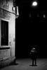 Street Light (stefanopad82) Tags: venice italy street night bw black white photography kid child girl window winter alone dark mistery cold old