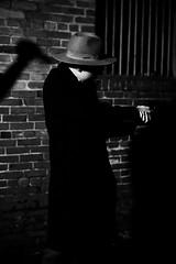 NOIR VIIII (giladvalkor) Tags: noir suit hat blackandwhite bw monochrome alley 1940s 1950s darkphotography shadows night creepy scary man people portrait gun revolver silhouette contrast