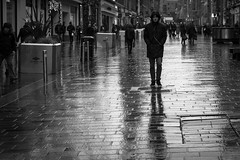 It'll Be Lonely This Christmas (Leanne Boulton) Tags: monochrome outdoor urban street candid photography streetphotography candidstreetphotography eyecontact candideyecontact streetlife man male face facial expression look emotion feeling mood atmosphere rain raining wet weather winter cold reflection reflective paving christmas shopping tone texture detail depth natural light shade shadow city scene human life living humanity people society culture canon 5d canon5dmarkiii 70mm bw ef2470mmf28liiusm black white blackwhite mono blackandwhite glasgow scotland uk