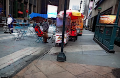 Food Carts & Sweeping Hard (Robert S. Photography) Tags: foodcart peanuts man sweeping subway ad chairs tables madisonsquaregarden city street scene manhattan nyc sony january 2017 dscwx150