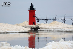 South Haven Lighthouse from the Ice (Jeff Meeker) Tags: lakemichigan westmichigan winter winterwonderland weathered winterlife ice splash sparkle reflection reflections allthingsmichigan absolutemichigan artistic adventure slippery bluesky canon canont4i canondslr canon650d colorful clouds cloudsstormssunsetssunrises cold coldwater daylight day dangerousseas exploremichigan explore groupswithexperience interesting interestingness january 2017 lakeeffect michigan michigangottaluvit midwest michiganisamazing michiganlighthouses nature naturespaintbrush outdoorbeauty outdoorphotography outdoorphotographer outdoorphotos puremichigan photographersofwestmichigan peaceful quality southwestmichigan snow sunlight sunset stjosephmichigan stjoseph southhavenlighthouse southhaven southhavenpier thisisourmichigan themichigangallery theworldoutdoors vibrant texture newyearsadventures