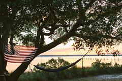 Memorial Day Weekend 2015 (Katie Swift) Tags: camping summer tree outdoors oak getaway flag northcarolina patriotic lazy american hammock redwhiteblue fortfisher kurebeach capefear campgrounds greatoutdoors campingequipment holidayweekends