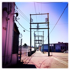 20150605-1324 (Straylight Productions) Tags: street city urban canada building architecture vancouver port alley industrial cityscape britishcolumbia streetphotography wires lane infrastructure electricity yvr eastside telephonepole iphone 2015 portdistrict iphoneography hipstamatic