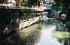 Khlong Sam Sen - Bangkok (jcbkk1956) Tags: worldtrekker water shade light restaurant bangkok thailand khlong canal victorymonument film 35mm analog fujica compact35 kodak gold200 200iso zonefocus manualfocus 38mmf28 thailandimages samsen footpath bridge