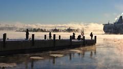 Seafog admirers (KaarinaT) Tags: ice silhouette people sea helsinki seafog mist freezingcoldweather beautifullight finland kaartinkaupunki pier water ship siljaline klippan