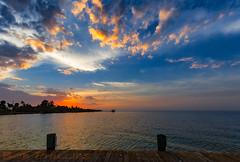 Bokeelia Sunset (tropicdiver) Tags: bokeelia florida pineisland clouds dock gulfofmexico palmtrees pier pineislandsound reflection southwestflorida sunset