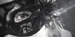 Behind the mask... (Maria Godfrida) Tags: macromondays inspiredbyasong behindthemask michaeljackson mask behind eye macro closeup blackandwhite lace blackflower woman 7dwf