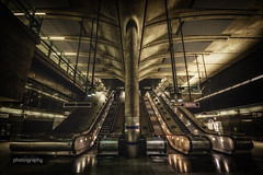 Spaceships dock here (Alex Chilli) Tags: canarywharf london escalator steps stairs wayout lights night futiristic spaceage underground tube metro train platform concourse station jubileeline empty deserted canon eos 70d
