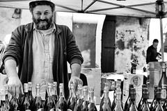 proud of my bottles of wine [Explored on  01/25/2017] (Claudia Merighi) Tags: blackandwhitephotos blackandwhiteonly blackwhitephotos noiretblanc bnbwbwbiancoenero bwportrait streetphotography street streetphotographers streetportrait fotografiadistrada fotografiacallejera fotodistrada fotografiederue pentaxk5 k5 claudiamerighi pretoebranco bottles wine monochrome monochromatic people nero bianco beard italy italianwine lambrusco bottiglie stand mercatino streetmarket