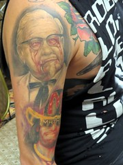 Revenge of the chickens for Col. Sanders. (kennethkonica) Tags: people usa men chicken tattoo america fun glasses vegan artwork women midwest indianapolis makeup indy tie indiana convention horror cons bloody clowns kentuckyfriedchicken canonpowershot vendors tatts whitesuit marioncounty colsanders artskin thatdamntattoocontest daysofthedays colonelharlensanders