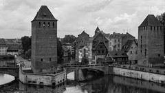 all along the watch towers (lunaryuna) Tags: france lalsace strasbourg urban city historiccentre architecture buildings watchtowers bridges pontscouverts canals medievalarchitecture timberframehouses citydefences walkinthecity urbanconstructs blackwhite bw monochrome lunaryuna