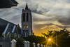 Lit tower (Cosmic Oxter) Tags: hdr dynamicrange sunset church churchtower sun sunlight window lightthroughwindow litwindow sunlitwindow orange orangeglow