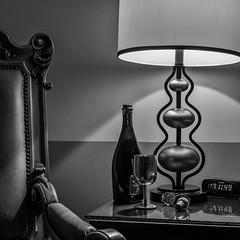 Almost Midnight- (treehuggerdcg) Tags: utata:project=ip247 utata:description=hide utata ironphotographer bw champagne champagnecork wire digitalclock lamp light chair leica