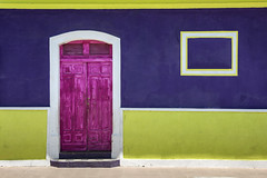 Maison colorée de Leon (Voyages Lambert) Tags: leonnicaragua retrostyled travel buildingexterior lookingatview textured crumble art midsection wheel colonialstyle history thepast creativity romance dirty oldfashioned old cultures architecture vacations outdoors closeup nicaragua theamericas peel door window wallbuildingfeature house street city town paint style charming
