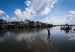 Mekong 04 (arsamie) Tags: mekong river delta vietnam asia southeast water reflection cloud house boat blue old rust ho chi minh saigon tho can