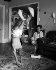 Lounge Gymnastics 01 copy (C & R Driver-Burgess) Tags: boys girl shaved forehead blonde curly hair young small headstand spider walkover monochrome playing kids children