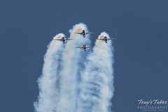 The Thunderbirds four ship coming over the top of a loop