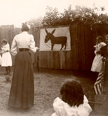 Pin the Tail on the Donkey (Cropped) (Alan Mays) Tags: ephemera photographs photos foundphotos donkeys animals tails pinthetailonthedonkey games playing play women teachers blindfolds blindfolded tall thin slim children boys girls students fans advertisingfans flags clothes clothing dresses sailorsuits fences antique old vintage vptp