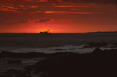kona sunset 5 (bone__saw) Tags: ocean sunset sky film beach clouds hawaii waves scan velvia telephoto nikkor nikonf3 kona thebigisland reversal 200mm epsonv600