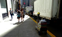 Slice of Sunlight in the Financial District (spinadelic) Tags: sf sanfrancisco family slash vacation sunlight truck walking back sweater downtown hand looking district wheels daughter mother july sidewalk pedestrians delivery nocal vest sodas financial stevespencer 2015