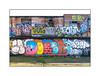 Street Art (Holmesfromthecrypt), East London, England. (Joseph O'Malley64) Tags: holmesfromthecrypt britainsnexttopkebab döner four nigel graffiti streetart urbanart art artist artistry artwork brickwork bricksmortar pointing rundown flatroofs windows shutter rollershutter vent polypipe derelict derelictland concrete reinforcedconcrete litter rubbish waste detritus urban urbanlandscape aerosol cans spray paint