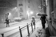 Captain snow (Simone.Marengo) Tags: snow street umbrella ombrello vecchio people walk white snowflake black bn oldman man woman strada gente neve weather