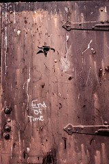 End Of Time (c. Melon Images) Tags: street door hinge city urban detail texture philadelphia grit fuji grafitti message outdoor philly manualfocus