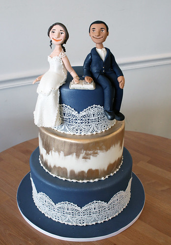Navy Blue and Gold Wedding Cake with Bridge Groom Bible