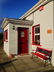Oak Tree Cottage (JulieK (thanks for 8 million views)) Tags: hww wall window iphone5 bench white red winter sunshine bluesky 117picturesin2017 2017onephotoeachday door mat pot flowers ireland irish wexford