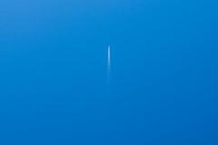 leaving (Sean Garrett (blacktau)) Tags: blue sky color nature ecology colors clouds scenery skies contrail colours aircraft jet environment environmentalism ecosystem airtransportation